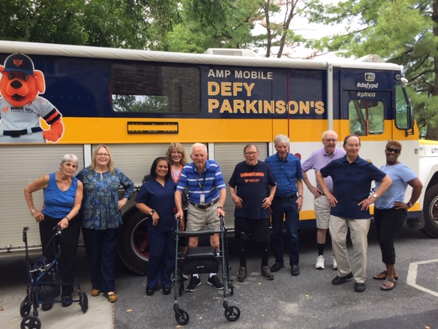 Community of people in front of the Parkinson's Mobile