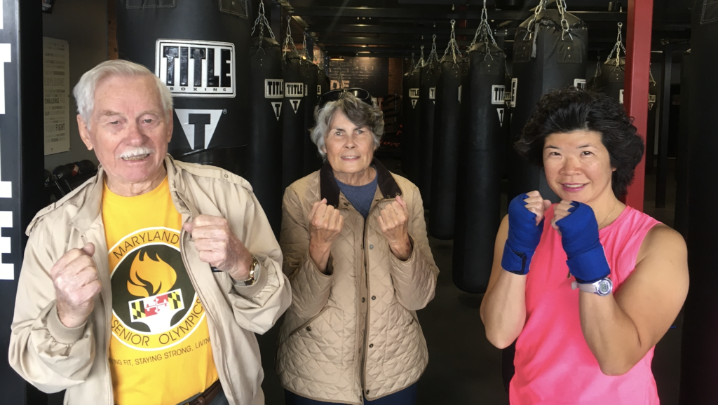 Three people boxing