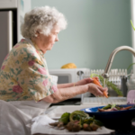 Woman with Parkinson's washing vegetables