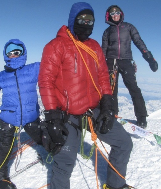 Three people dressed in winter layers