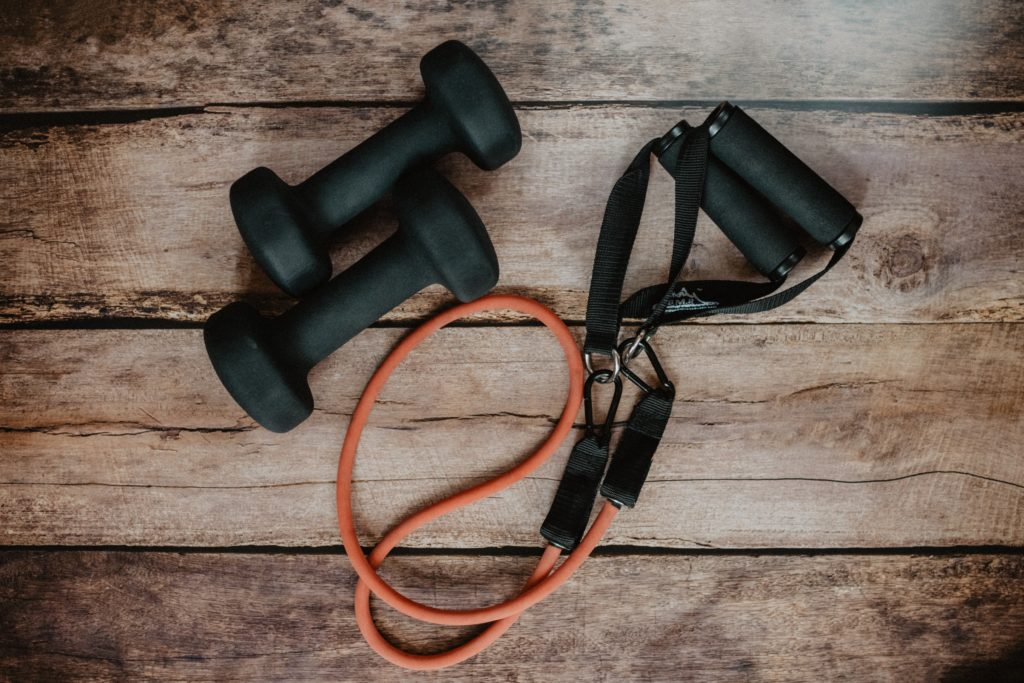 Photo by Kelly Sikkema on Unsplash  Equipment used for at home exercising
